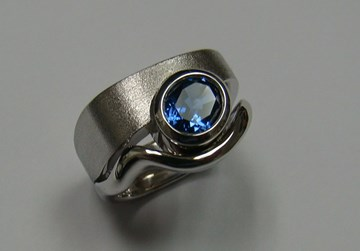 Oval Blue Sapphire Bezel Set in White Gold